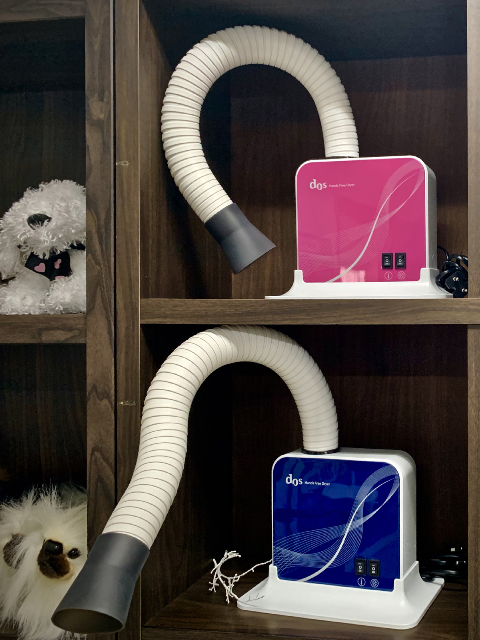 IM Co., Ltd designs multi-purpose, hands-free dryers to make giving pets baths easier.