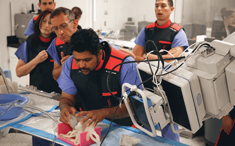 Dr. Iyer evaluates a patient-speci c heart model during a surgery dry-run prior to treating the patient.